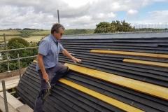 Sean-Flynn-on-roof-scaled